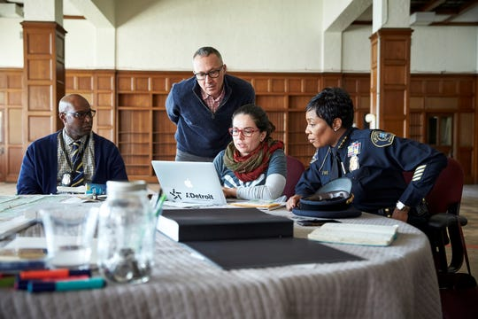 Left to right, Detroit Police Officer Gregory Matthews, Marcus Lyon, Camila Pastorelli and First Assistant Chief of Police Lashinda Stair gather information for the I.Detroit project.