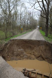 A portion of Braun Road in Saline Township collapsed Wednesday morning after periods of heavy rain. A culvert pipe underneath the road was aging and may have contributed to the road collapse. Braun Road, west of Macon, is closed until further notice.