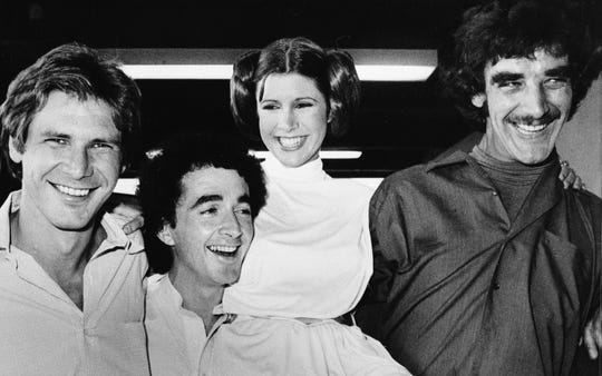 """In this Oct. 5, 1978 file photo, actors featured in the """"Star Wars"""" movie, from left, Harrison Ford, Anthony Daniels, Carrie Fisher and Peter Mayhew."""