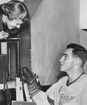 Red Kelly, shown here taking to a fan in 1955, played 13 seasons in Detroit,  helping the Red Wings win four Stanley Cups.