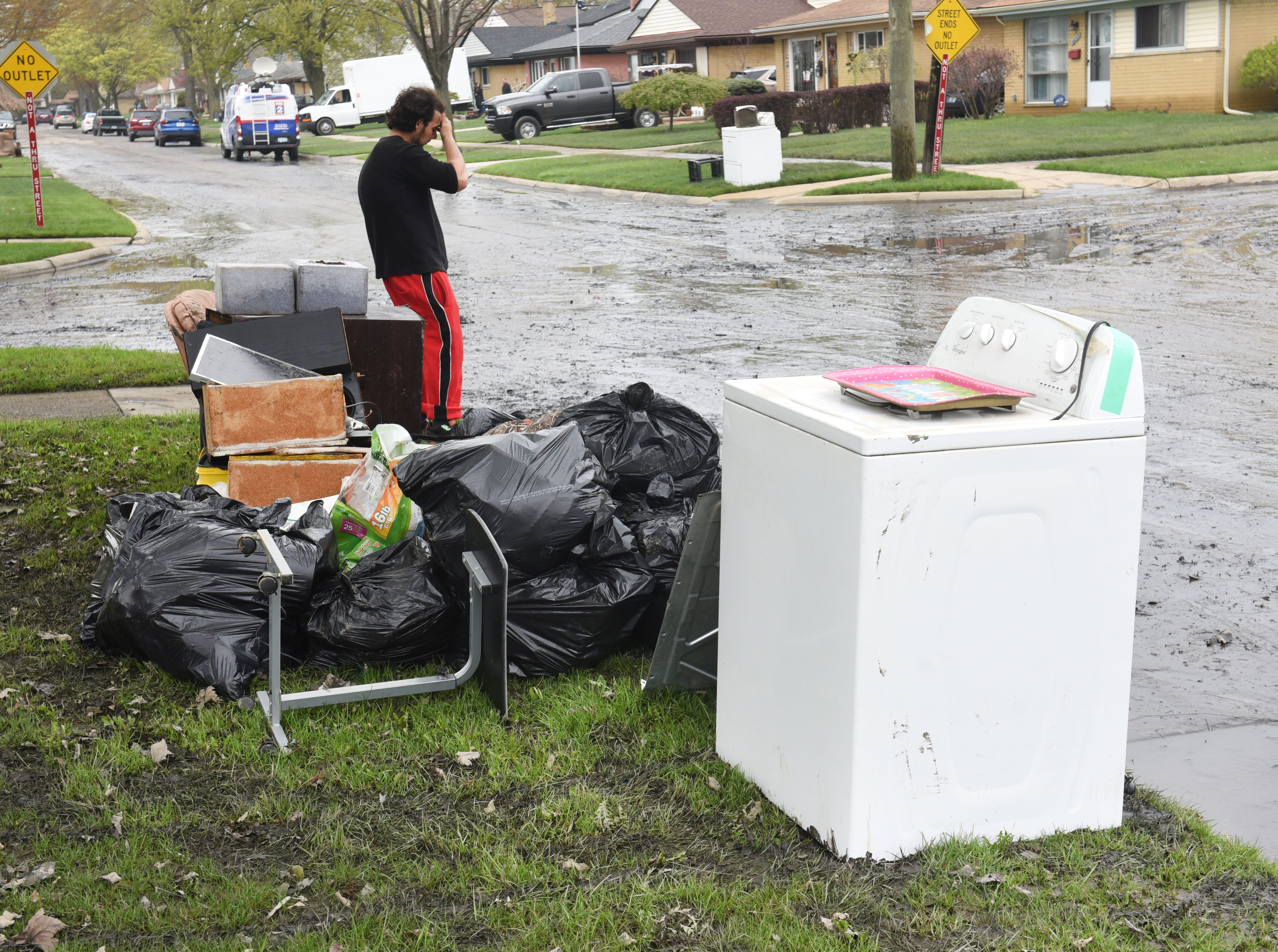 Dearborn Heights resident John Burbank can't believe the damage caused by floodwaters on Hanover Street, where basements were flooded and belongings ruined.