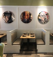 The main dining room of Zao Jun has colorful, hip pop art on the walls.