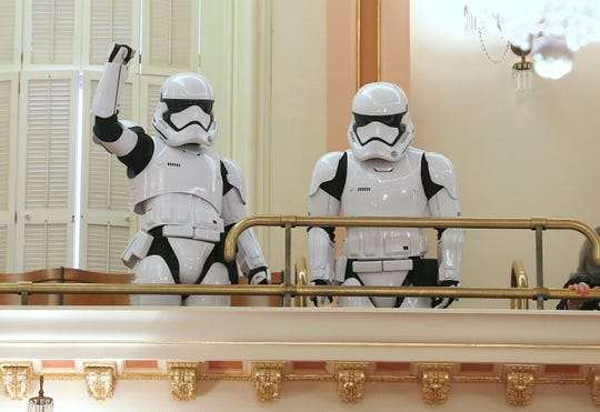 A pair of stormtroopers watch lawmakers in action from the gallery of the state Senate Chambers Thursday, May 2, 2019, in Sacramento, Calif.