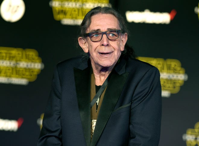 """In this Dec. 14, 2015, file photo, Peter Mayhew arrives at the world premiere of """"Star Wars: The Force Awakens"""" in Los Angeles."""