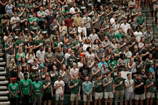 Students stand in Halton Arena during a vigil at the University of North Carolina-Charlotte in Charlotte, N.C., Wednesday, May 1, 2019.