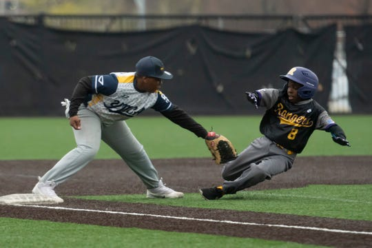 Daijon Brooks, of the 11U Detroit Rangers, is tagged out at third base by Isaih Clemons, of the YMCA Tigers, during a Police Athletic League scrimmage at The Corner Ballpark, in Detroit.