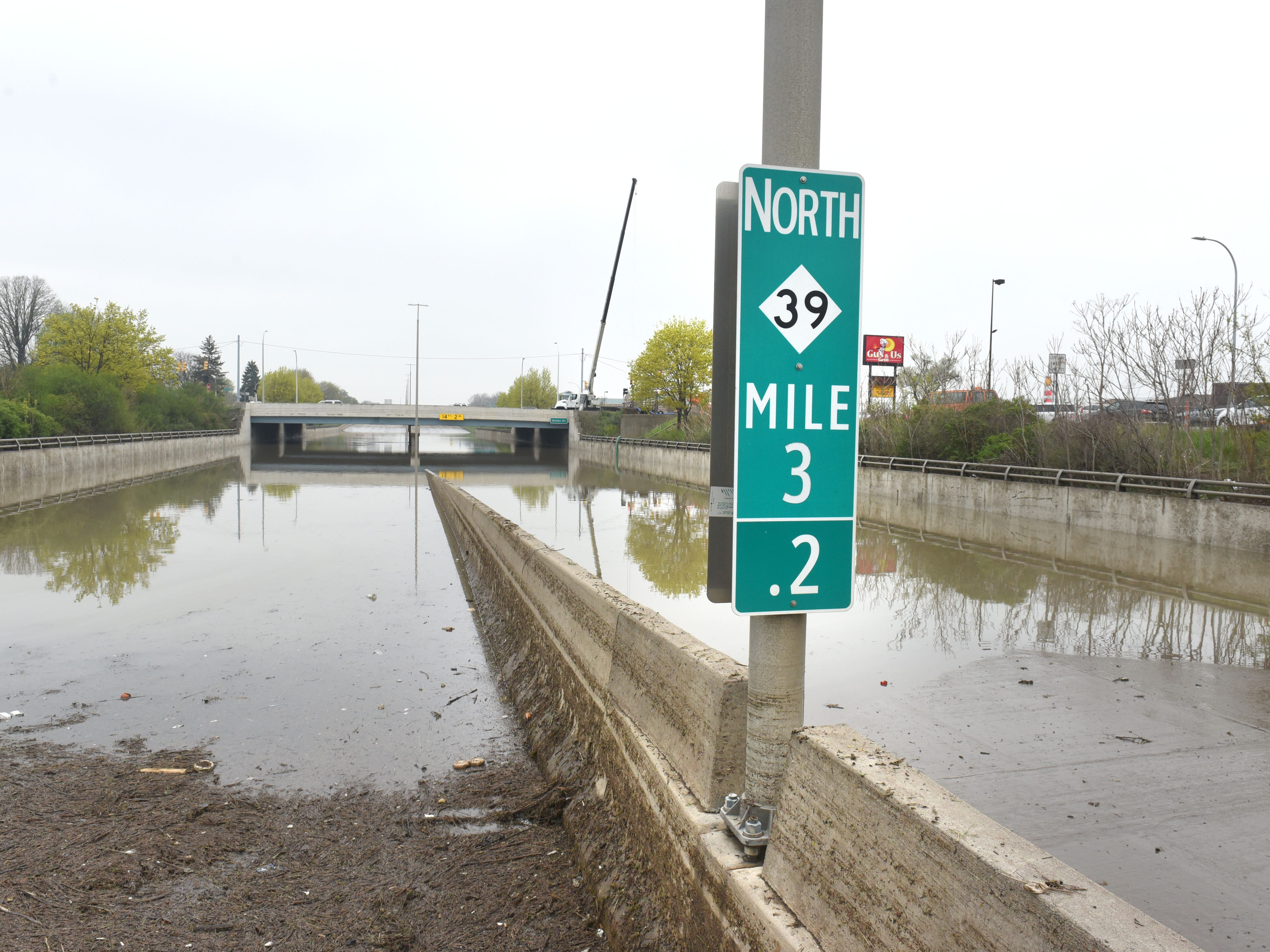 Southfield Road at Outer Drive remains closed as crews try to pump out water on Thursday, May 2, 2019.