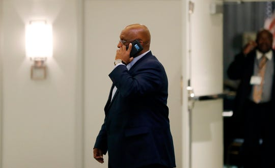 """Acting Baltimore Mayor Bernard """"Jack"""" Young talks on the phone outside the National Organization of Black County Officials annual Economic Development Conference, Thursday, May 2, 2019, in Detroit."""