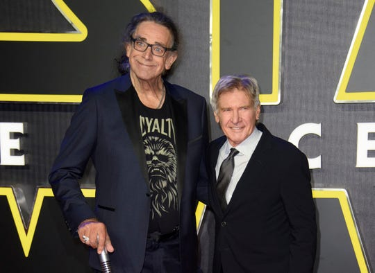 This Dec. 16, 2015 file photo shows Peter Mayhew, left, and Harrison Ford at the European premiere of the film 'Star Wars: The Force Awakens ' in London.