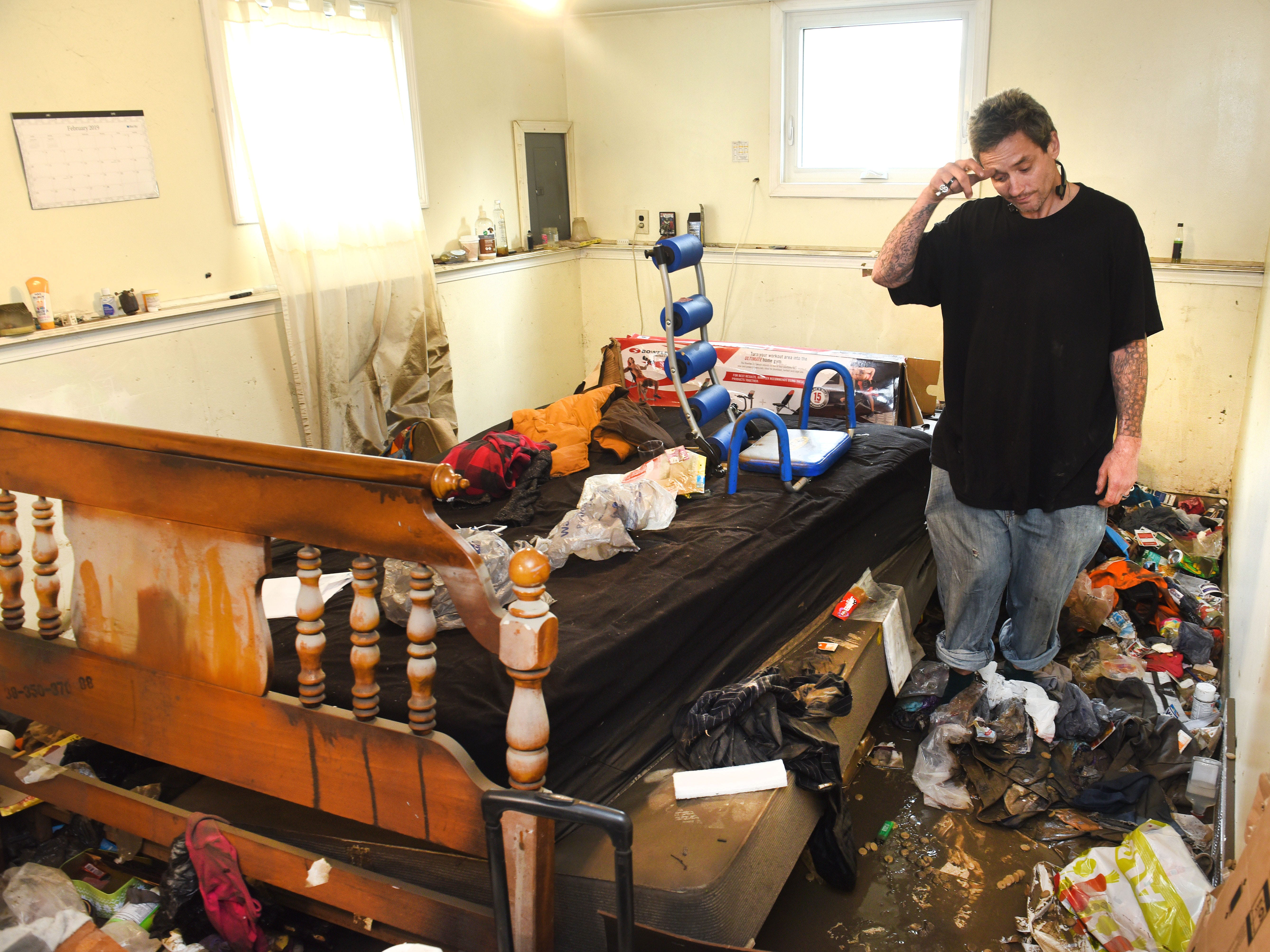 Jesse Sorrell wanders through his basement, amazed at the floodwater damage to his home and others along Hanover Street in Dearborn Heights on Thursday, May 2, 2019.