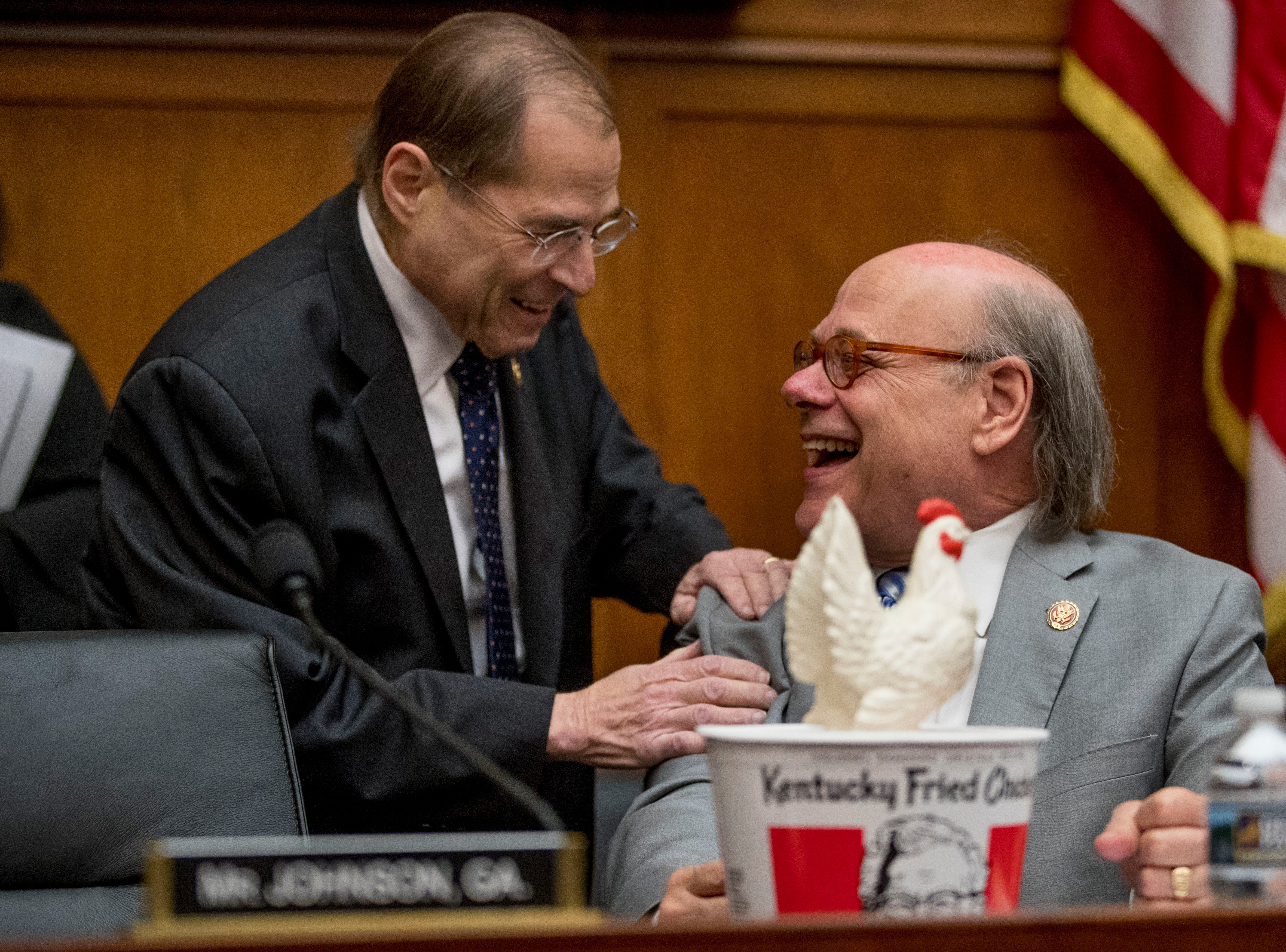 Judiciary Committee Chairman Jerrold Nadler, D-N.Y., left, laughs with Rep. Steve Cohen, D-Tenn., after Cohen arrived with a bucket of fried chicken and a prop chicken at a House Judiciary Committee hearing on Capitol Hill in Washington, Thursday, May 2, 2019. The witness chair was without its witness, as Attorney General William Barr informed the Democrat-controlled panel he was skipping the hearing on special counsel Robert Mueller's report, escalating an already acrimonious battle between Democrats and the Justice Department.