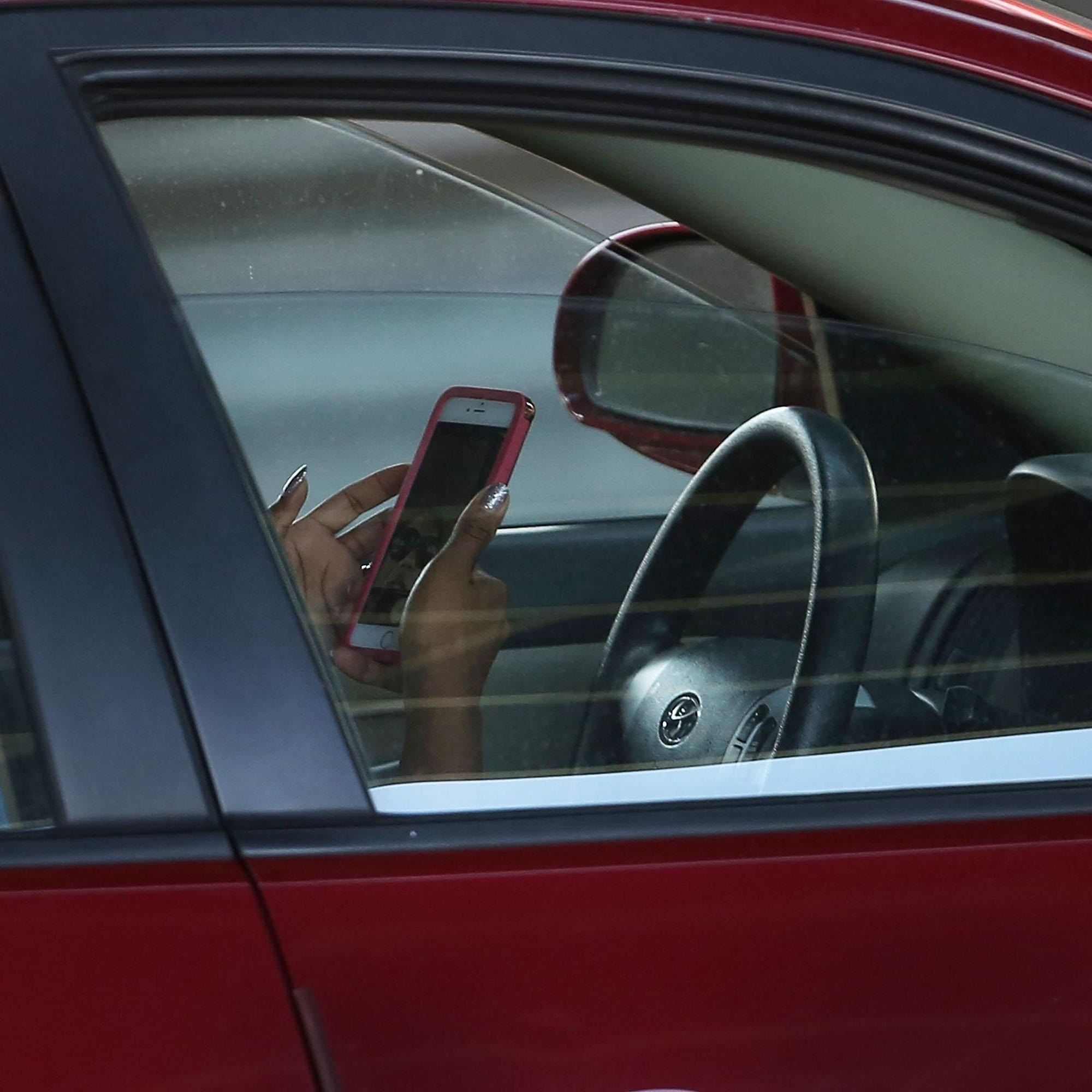 Insurers know exactly how often drivers touch their phones