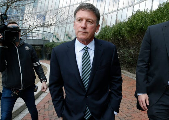 In this April 3, 2019 file photo, Bruce Isackson departs federal court in Boston after facing charges in a nationwide college admissions bribery scandal.