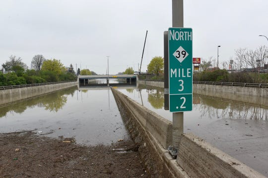 The Southfield Freeway at Outer Drive remains closed as crews try to pump out water on Thursday, May 2, 2019.