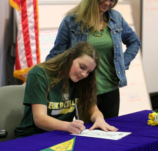 Thomas A. Edison senior Bella Willsey signs to play softball for Keuka College as her mom, Liz Manning, watches during a ceremony May 2, 2019 at Edison High School.