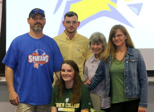 Bella Willsey, front, with family members, from left, father, Phil Willsey; brother, Cameron Willsey; grandmother, Jackie Manning; and mother, Liz Manning, after Bella signed to play softball for Keuka College at a ceremony at Thomas A. Edison High School on May 2, 2019.
