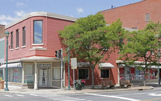 An Ithaca firm won a Preservation Award from Historic Elmira Inc. for restoring the former Werdenberg building in downtown Elmira.