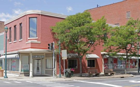 An Ithaca firm won a Preservation Award from Historic Elmira Inc. for restoring the former Werdenberg building in downtown Elmira.