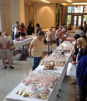 Crowds peruse the sweet treats at the 2014 Ultimate Bake Sale in the Old National Bank Henning Atrium.