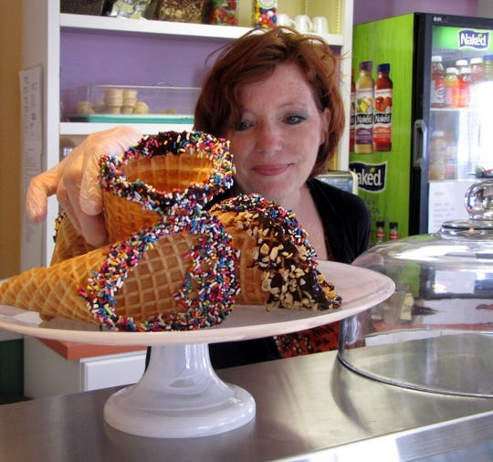 Penny Nejad arranges homemade ice cream cones in Ben and Penny's.