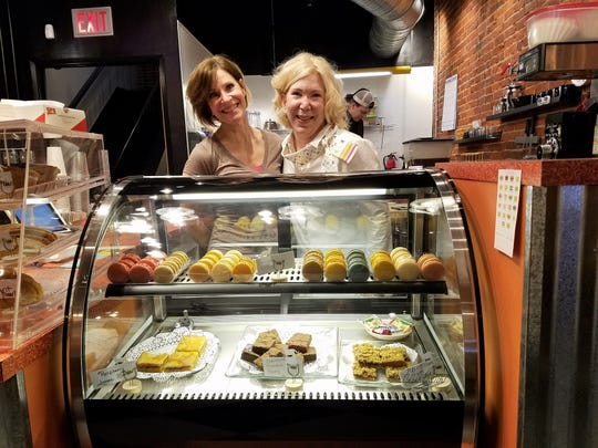 Annette Gries and Nancy Drake of River Kitty Cat Cafe with a few of the house treats.