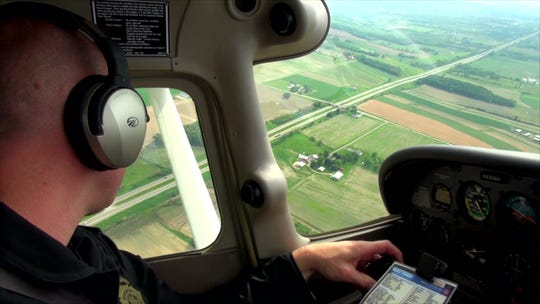 A Wisconsin State Patrol trooper conducts aerial traffic enforcement.