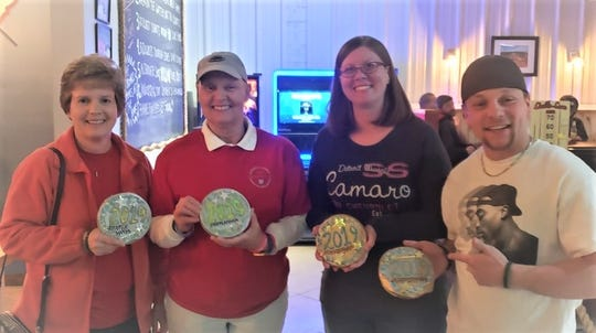 Winners of the 4th Annual Shufflemania tournament received gold and silver buscuits.