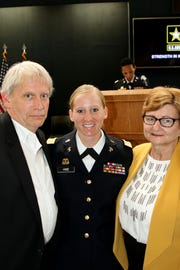 Amanda M. Hise, a 2004 graduate of Gibsonburg, graduated the United States Army Warrant Officer Candidate School at Fort Rucker, Alabama on April 10. WO1 Hise is pictured with her mother, Karen and father, Doug. She is assigned to the 259th Military Intelligence Brigade in Tumwater, Washington.