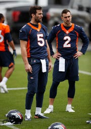 Denver Broncos quarterbacks Joe Flacco, left, and Garrett Grayson take part in drills during an NFL football veterans minicamp at the team's headquarters Tuesday, April 16, 2019, in Englewood, Colo. Grayson, a former CSU star, was waived by Denver on Thursday.