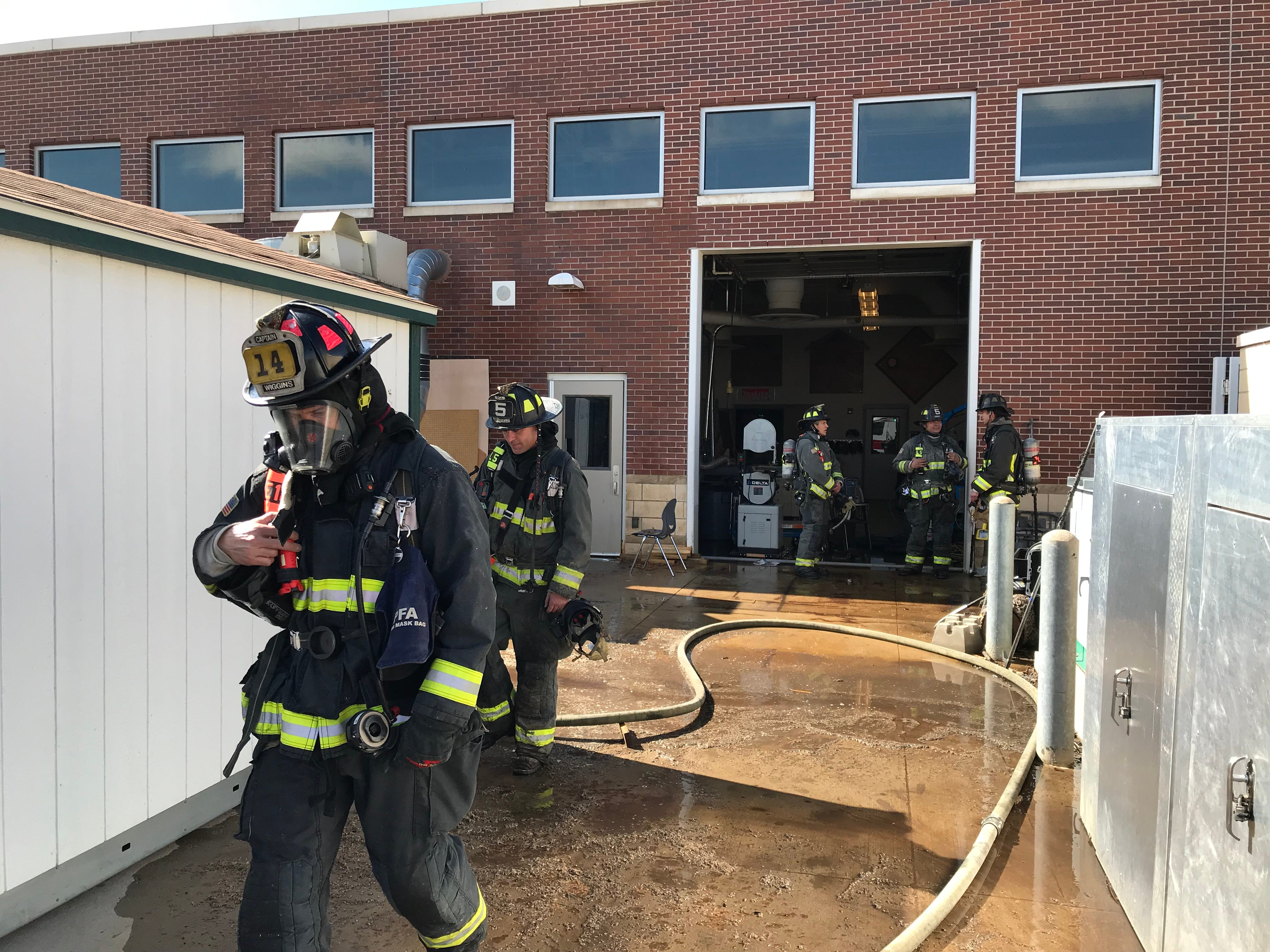 Poudre Fire Authority works to extinguish a fire in a dust collector on Thursday at Fossil Ridge High School