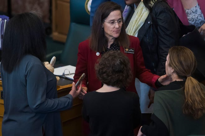 Colorado State Rep. Jeni Arndt talks with others before breaking off lunch on Thursday, May 2, 2019, at the Colorado State Capital in Denver, Colo.