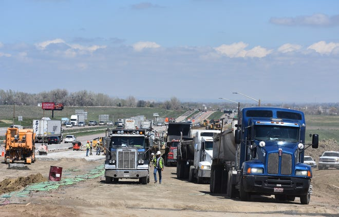 Semi-trucks with road base line up along the northbound ramp at Interstate 25 and Colorado Highway 392 on Thursday. That ramp will be closed Friday night through Monday morning to allow crews to remove old pavement,  pave a new concrete ramp, relocate the ramp metering system and add temporary asphalt paving with striping.