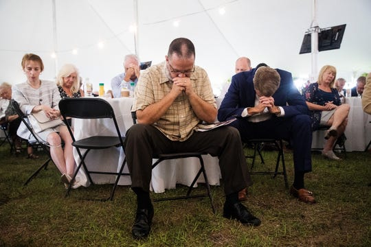 From left, Pastor John Edwards and Bill White attend the 2019 Community Prayer Breakfast at City of Palms Park on Thursday, May 2, 2019. The keynote speaker was Michael Hingson who escaped with guide dog Roselle, from the 78th floor of Tower One of the World Trade Center moments before it collapsed on 911. Hingson has been blind since birth.