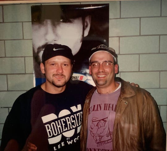 Tim Wentworth, right, was working for Midwest Communications when he posed with Tim McGraw backstage in the late '90s.