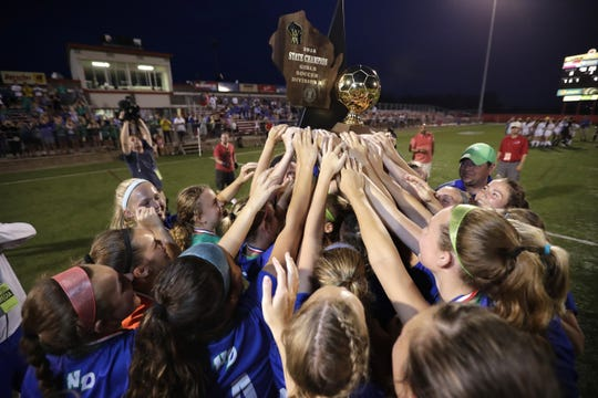 Green Bay Notre Dame High School players celebrate their victory against Catholic Memorial High School during their WIAA Division 3 final girls state soccer game in 2018.