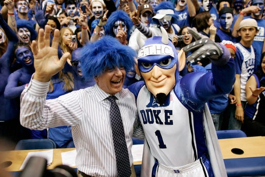 ESPN analyst Dick Vitale goes blue hair prior to a game between Duke and North Carolina in Durham, N.C.