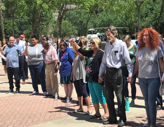 Charlotte residents pray for an end to violence that has claimed four lives this week, including the fatal shootings of two University of North Carolina Charlotte students on Tuesday.