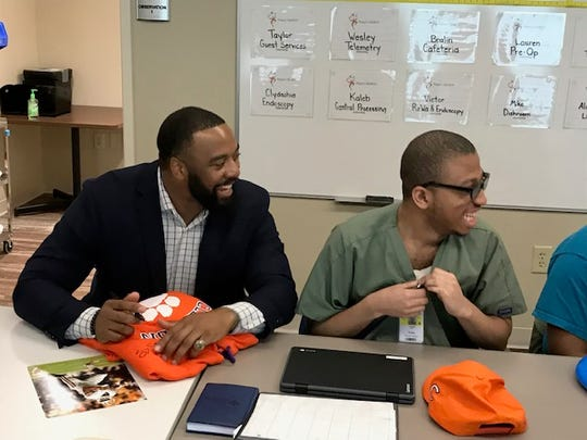 Former Clemson football star Tajh Boyd visits students in the Project SEARCH program at St. Francis Downtown.