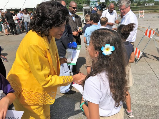 Greenville City Councilwoman Lillian Brock Flemming greets Isabella Puerta, a student from nearby A.J. Whittenburg Elementary, on Thursday, May 2, 2019, at the site of the future Unity Park off Hudson Street.