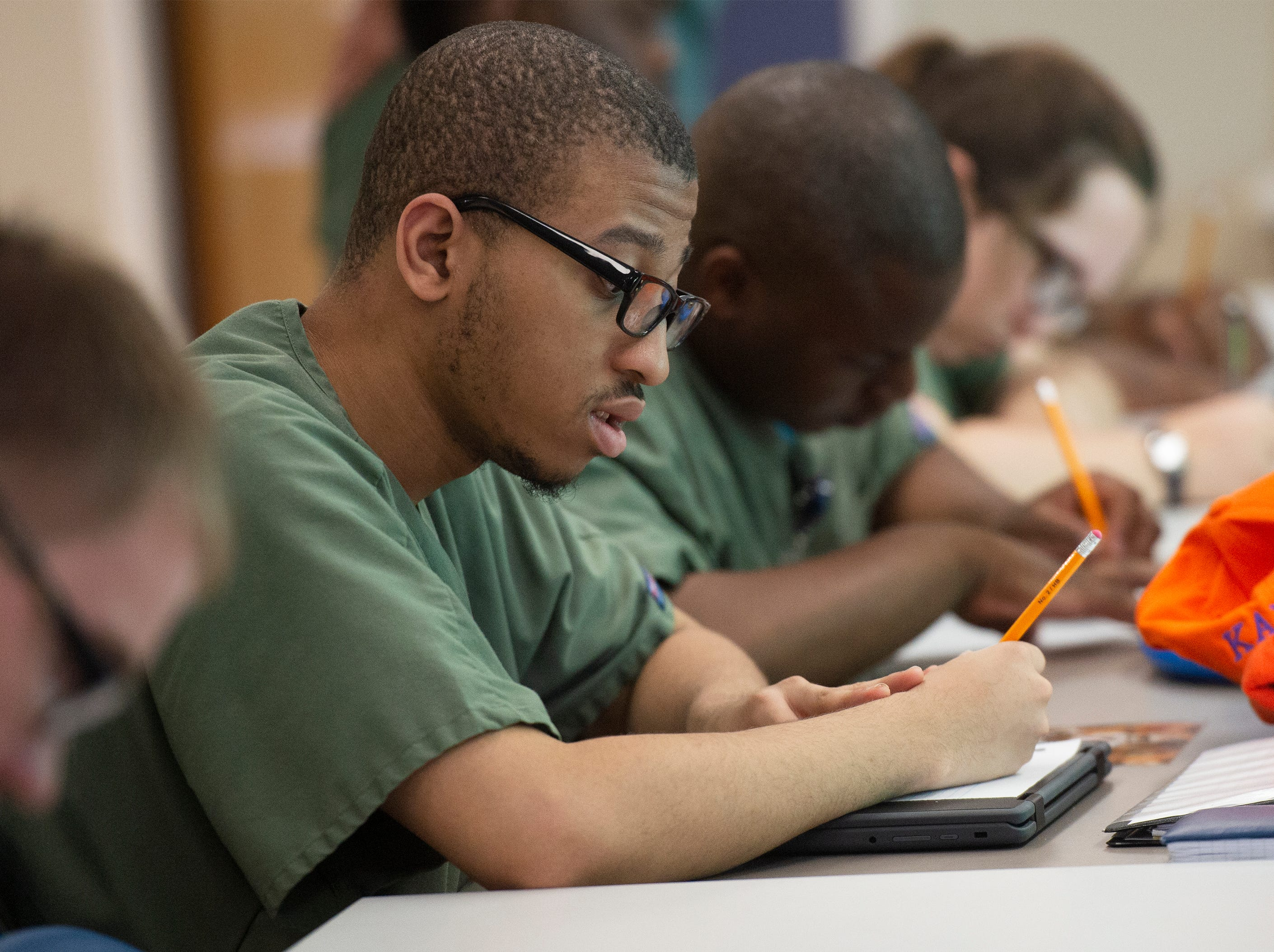 Kaleb Watkins writes a draft of a thank you letter to Tajh Boyd after Boyd visited the Project SEARCH class Thursday, May 2, 2019.