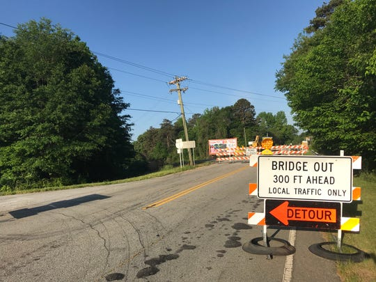 Signs mark a detour around one of two Highway 20 bridges that have been shut down for months. May 2, 2019