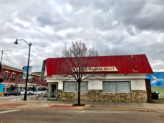 Some action is afoot at Tracy's Restaurant, which closed last year. The corner sign recently came down. The building at 127 Central Ave. was built in 1938 as Hank's Kitchenette.