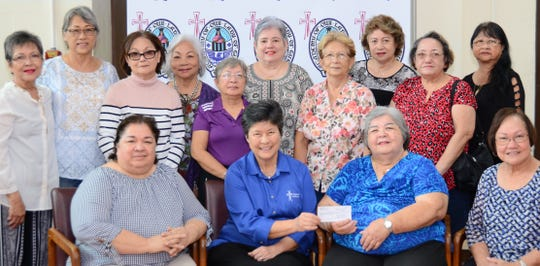 The All-Island Class of 1968 recently donated to the Academy of Our Lady of Guam's Athletic Scholarship Fund. The All-Island Class of 1968 consisted of class members from the four high schools on Guam in 1968:  Academy of Our Lady of Guam, FDMS, GW, and JFK. Kudos to the Class of 1968 in celebration of their yearlong 50th anniversary reunion and for their generous donations to help their alma maters. Pictured in front row from left:  Laling Pangelinan (AOLG), Sr. Angela Perez, RSM '64 (AOLG president), Gloria W. Borja ( JFK), and Mary A.T. Meeks '69 (AOLG Principal). Back row: AOLG Class of 1968 members present: Leling Merfalen, Judith P. Salas, Arlene Pangilinan, Bernadette Lou Sablan, Evelyn S. Leon Guerrero, Laura M. T. Souder, Lisa Bitanga, Roseleen M. Brown and, JFK Class of 1968 members, Terri Delos Reyes and Marissa Q. Mears.