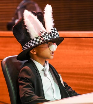 A cast member of Tamuning Elementary School portrays the Mad Hatter during the Law Day mock trial Queen vs. Alice in Wonderland at the Guam Judicial Center in this May 1, 2019, file photo.