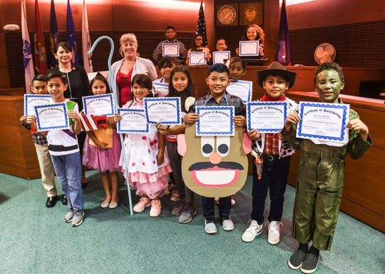 "Cast members of Price Elementary School's ""People vs. Woody"" mock trial and others gather at the Guam Judicial Center in Hagåtña on Wednesday, May 1, 2019. The mock trials school perfomances, with scenarios based on fictional and movie characters, were held in celebration of annual Law Day activities. Additional mock trials are scheduled to be held again for the public, starting at 6:00 p.m. on May 8 and 9."