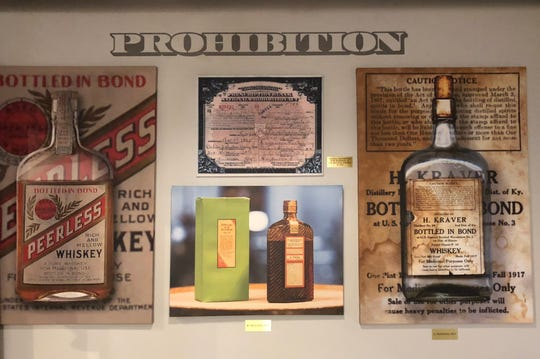 """A display at the Kentucky Peerless distillery features a pair of Prohibition-era bottles of """"medicinal"""" whiskey produced at Henry Kraver's old distillery in Henderson as well as a Henderson doctor's 1925 prescription for a pint of the liquor."""