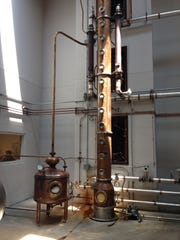 Kentucky Peerless' 26-foot-tall continuous copper still is at the heart of the distillation of bourbon and rye whiskey at the company's distillery in Downtown Louisville.