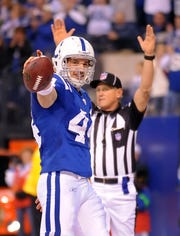 Indianapolis Colts' Dallas Clark celebrates his touchdown in the third quarter of a game against the Cincinnati Bengals.