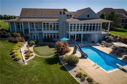 This $1.8 million Bargersville home comes with a putting green and saltwater pool.
