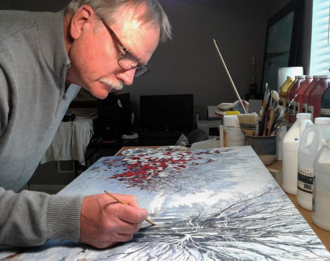 Artist Don Hetzel prefers to stand as he paints in his lower-level studio in his Coralville home. Retired after teaching art for nearly 40 years in Keokuk, his total focus is now on his studio art.